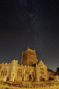 Starry night sky above St George's Church, Dunster